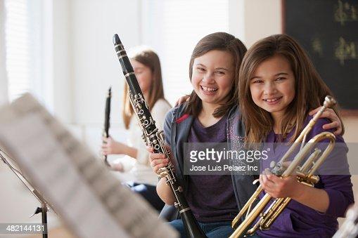 Portrait of smiling Caucasian girls in music class : Stock Photo
