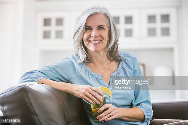 Portrait of smiling Caucasian woman drinking iced tea