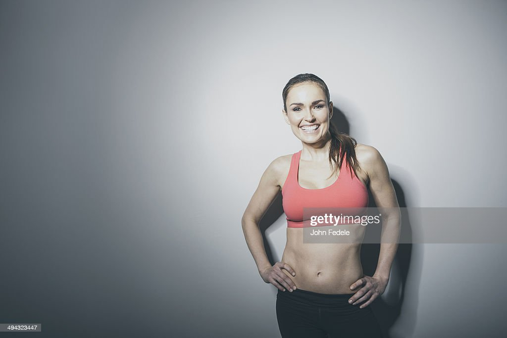 Portrait of smiling Caucasian woman in sports-bra : Stock Photo