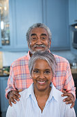 Portrait of smiling couple in kitchen at home
