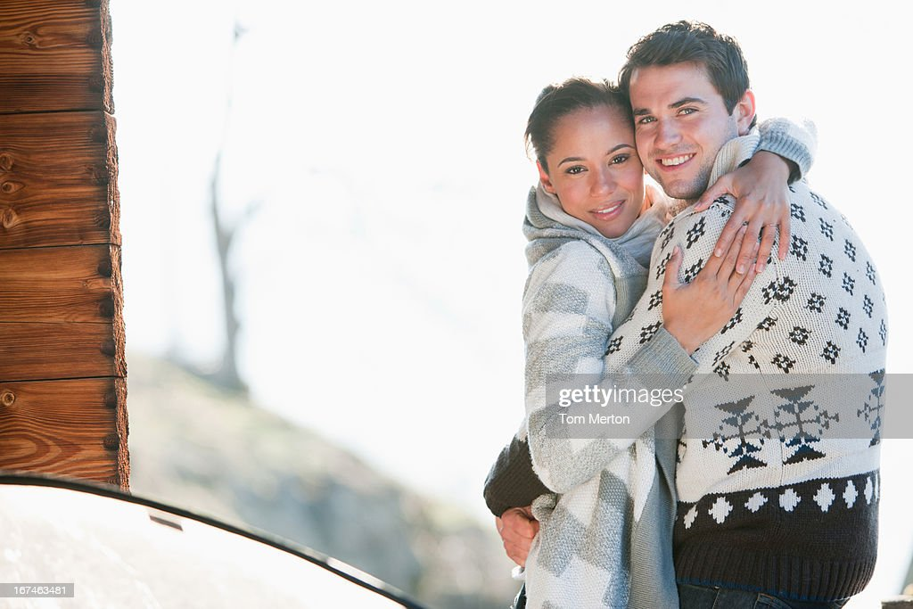 Portrait of smiling couple hugging : Stock Photo