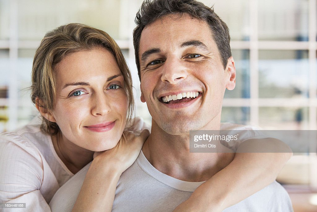 Portrait of smiling couple, outdoors : Stock Photo