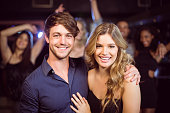 Portrait of smiling couple in a nightclub
