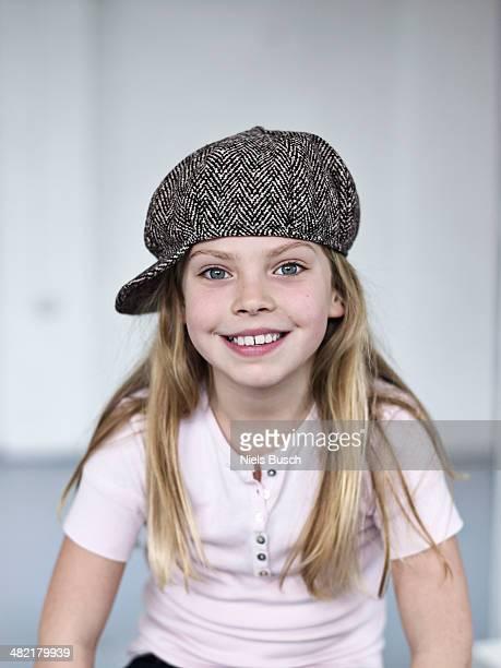 Portrait of smiling cute girl wearing a tweed cap
