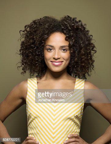 Portrait of smiling dark skinned female