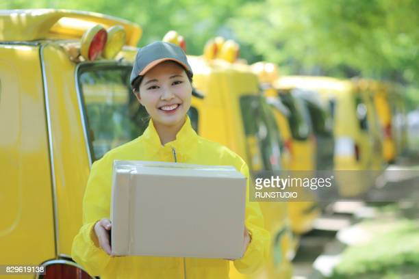 Portrait of smiling delivery woman