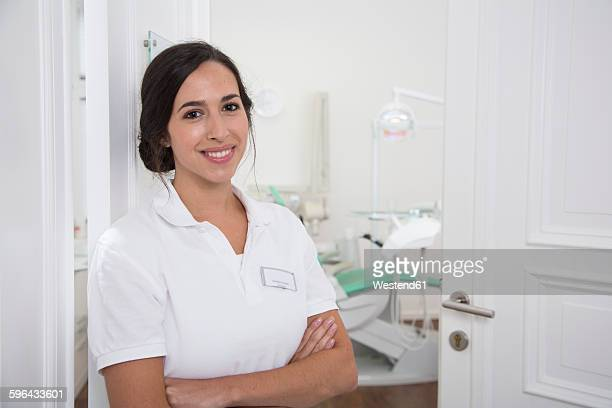 Portrait of smiling dentist at surgery