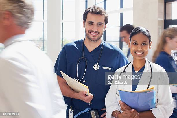 Portrait of smiling doctor and nurse in hospital