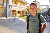 Portrait of smiling elementary school boy with his backpack
