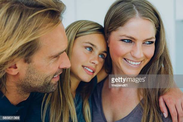 Portrait of smiling father, mother and daughter