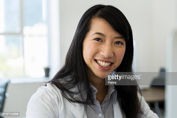 Portrait of smiling female doctor at clinic