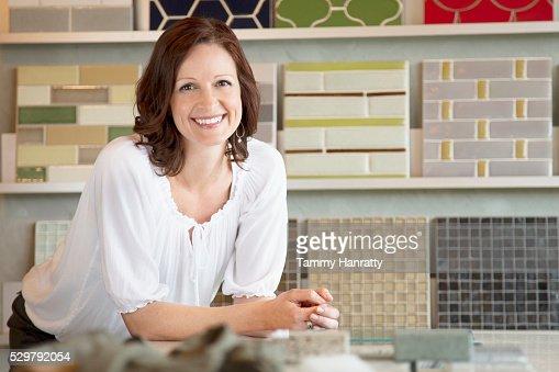 Portrait of smiling female in store : Stock-Foto