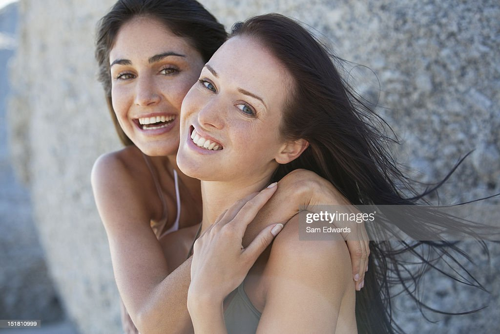 Portrait of smiling friends hugging
