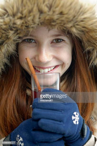 Portrait of smiling girl holding glass of hot punch