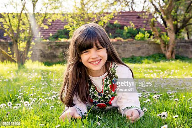 Portrait of smiling girl lying on a meadow