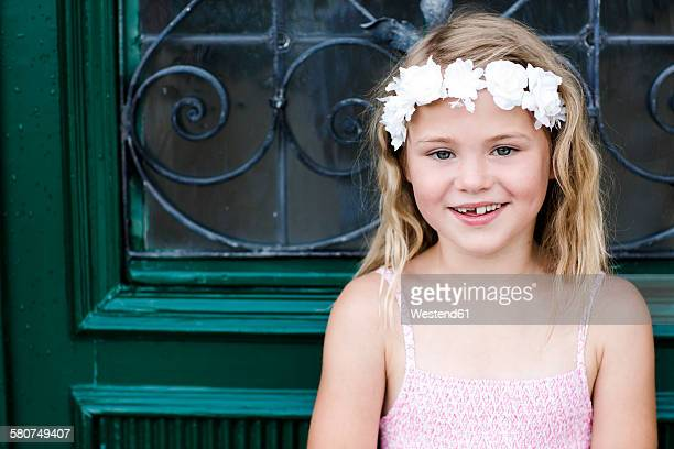 Portrait of smiling girl with tooth gap wearing floral wreath