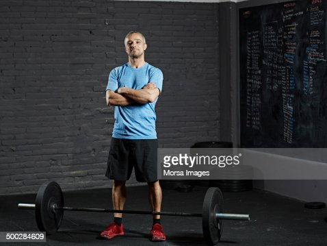 Portrait of smiling gym with barbell