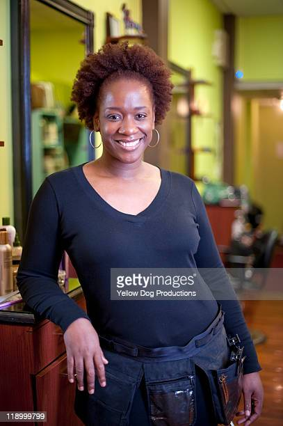 Portrait of Smiling Hair Stylist in Salon