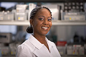 Portrait of smiling healthcare worker in hospital supply room