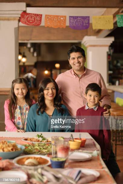 Portrait of smiling Hispanic family in restaurant