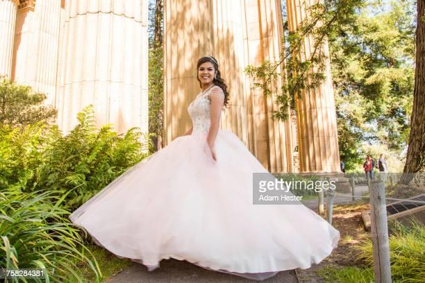Portrait of smiling Hispanic girl wearing gown
