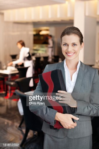 Portrait of smiling hostess in restaurant