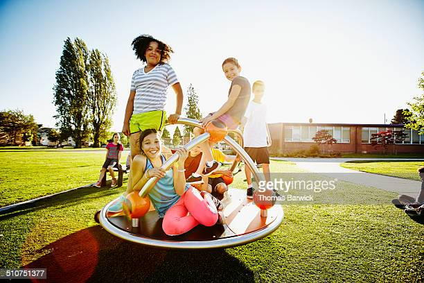 Portrait of smiling kids on merry go round