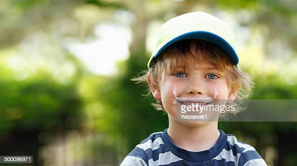 Portrait of smiling little boy with milk moustache