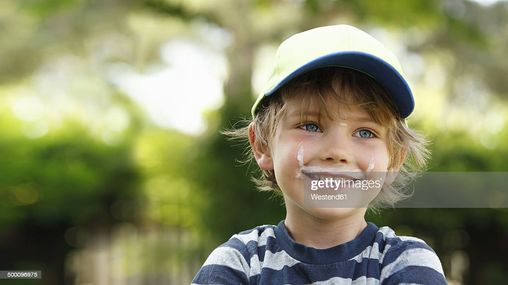 Portrait of smiling little boy with milk moustache