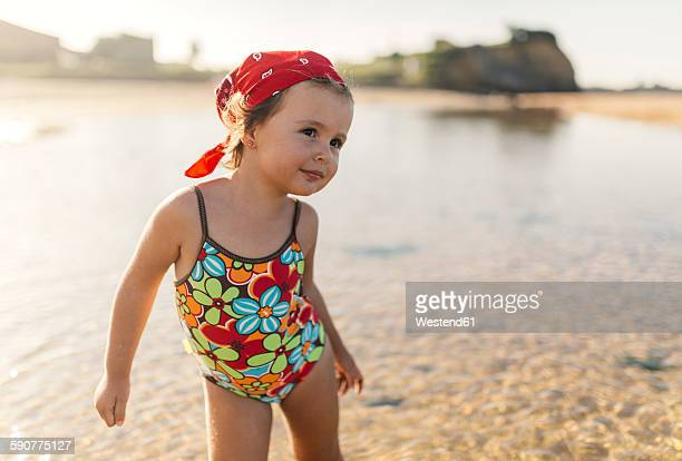 Portrait of smiling little girl wearing swim suit with floral design