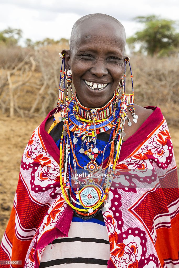 Portrait of smiling Maasai woman with elaborate traditional jewellery : Stock Photo