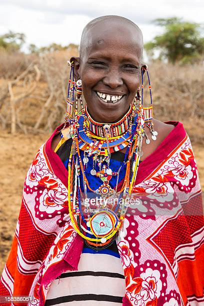 Portrait of smiling Maasai woman with elaborate traditional jewellery