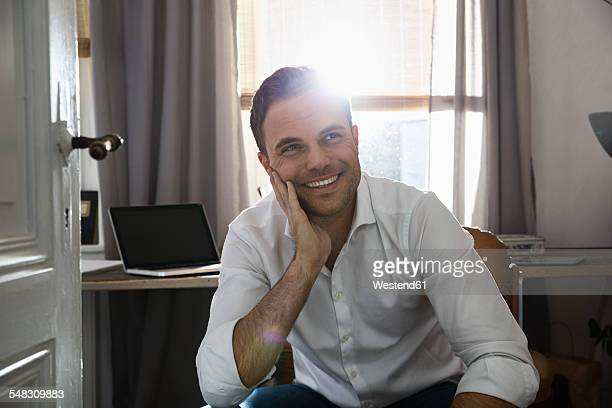 Portrait of smiling man at his home office