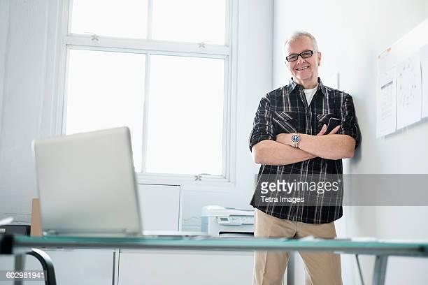 Portrait of smiling man in modern office