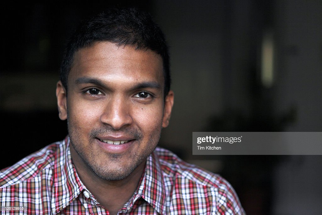 Portrait of smiling man in plaid shirt : Stock Photo