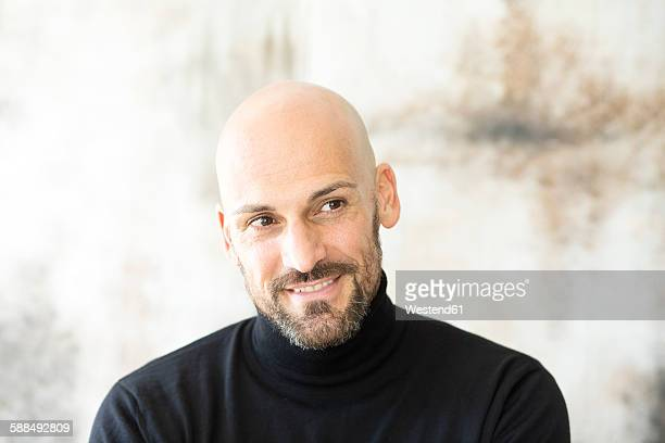 Portrait of smiling man wearing black turtleneck