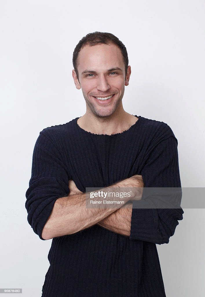 portrait of smiling man with arms crossed : Stock Photo