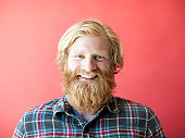 Portrait of smiling man with beard, studio shot