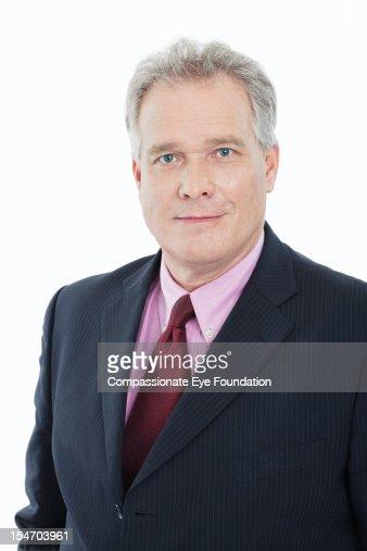 Portrait of smiling mature businessman : Stock Photo