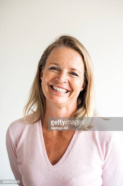 Portrait of smiling mature female teacher in classroom
