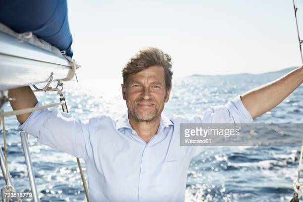 Portrait of smiling mature man on sailing boat