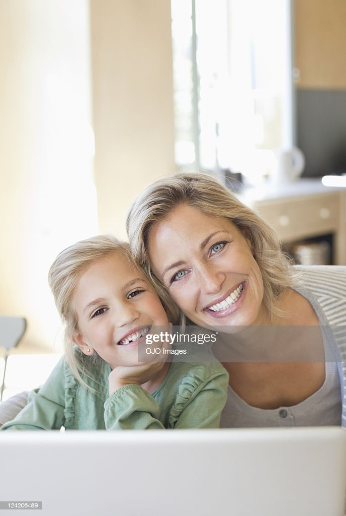 Portrait of smiling mature woman with daughter : Stock Photo