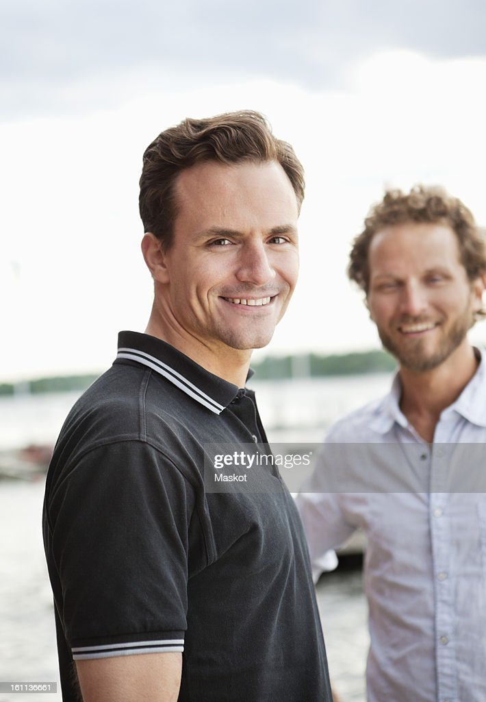 Portrait of smiling men looking at camera : Stock Photo