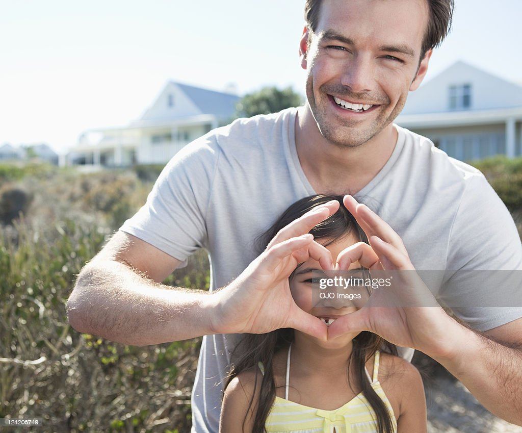 Portrait of smiling mid adult man having fun with little daughter