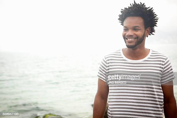 Portrait of smiling mid adult man on Ipanema beach, Rio De Janeiro, Brazil