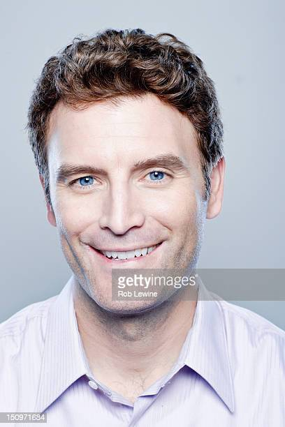 Portrait of smiling mid adult man, studio shot