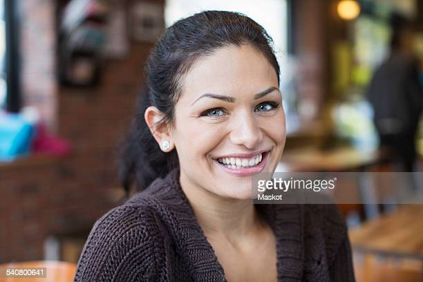 Portrait of smiling mid adult woman in restaurant