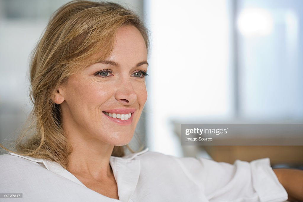 Portrait of smiling mid adult woman : Stock Photo