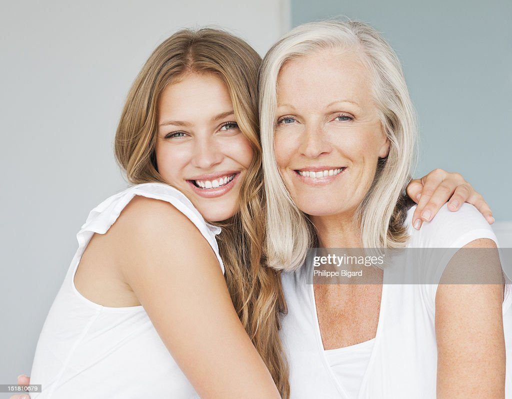 Portrait of smiling mother and daughter hugging : Stock Photo