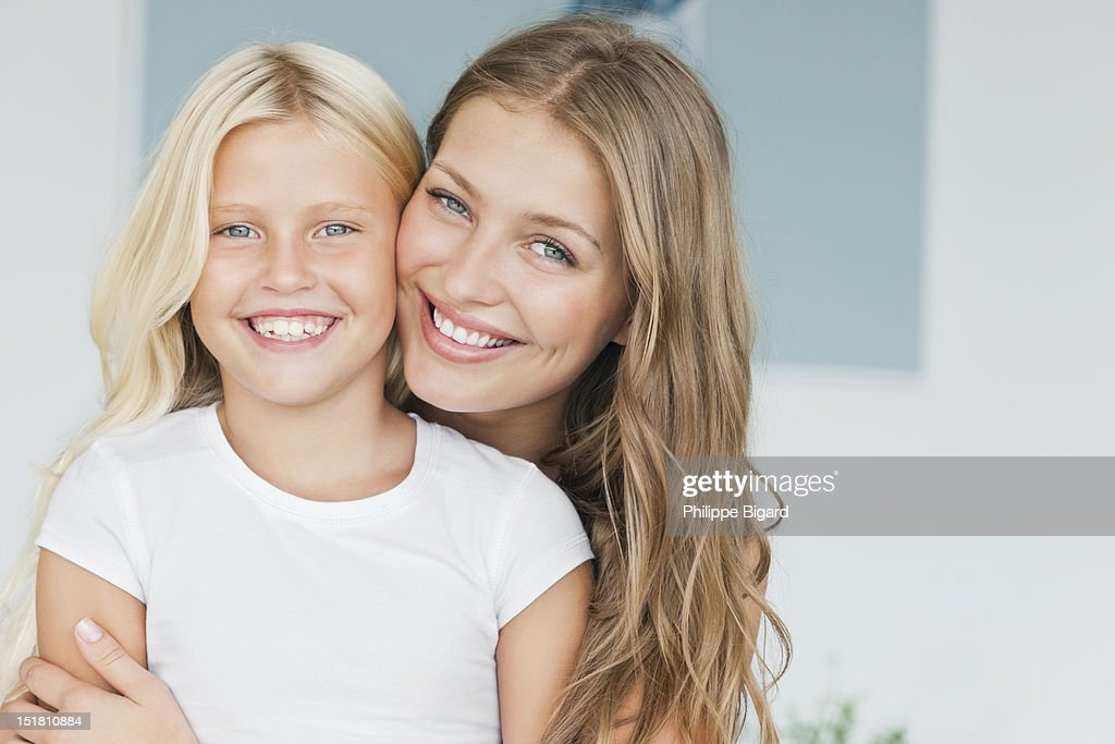 Portrait of smiling mother and daughter : Stock Photo